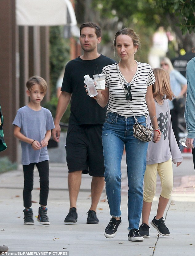 Over: Tobey Maguire and Jennifer Meyer, pictured here with son Otis and daughter Ruby on Sunday, have split after nine years together